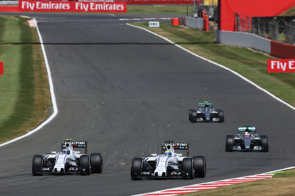 Felipe Massa (BRA) Williams FW37 and team mate Valtteri Bottas (FIN) Williams FW37 battle for position. 05.07.2015. Formula 1 World Championship, Rd 9, British Grand Prix, Silverstone, England, Race Day.  - www.xpbimages.com, EMail: requests@xpbimages.com - copy of publication required for printed pictures. Every used picture is fee-liable. © Copyright: Davenport / XPB Images