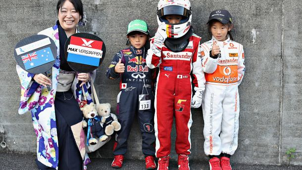 SUZUKA, JAPAN - OCTOBER 06: Fans supporting Red Bull Racing, Ferrari and McLaren during previews ahead of the Formula One Grand Prix of Japan at Suzuka Circuit on October 6, 2016 in Suzuka. (Photo by Mark Thompson/Getty Images)